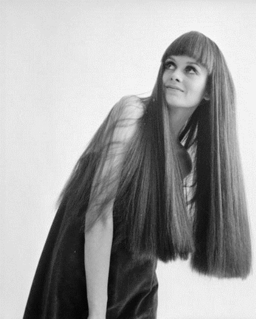16th March 1967: British fashion model and 60s icon Twiggy models a long dark wig with a severe fringe. (Photo by McKeown/Express/Getty Images)