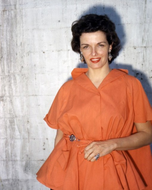 Jane Russell (1921-2011), wearing an orange dress, with large drop earrings, in a studio portrait, against a white background, circa 1955. (Photo by Silver Screen Collection/Getty Images)